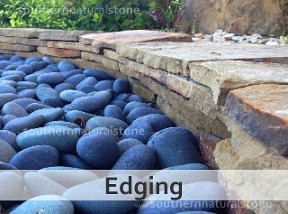 Landscape edging with mexican beach pebbles, Texas